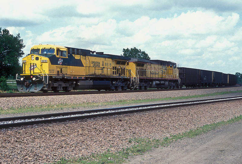 A pair of Operation Lifesaver units together, Chicago & North Western C44-9ACW 8818 and Union Pacific C44-9ACW 6736 (formerly CNW 8834), arrive from the east at North Platte on 11 July 1998