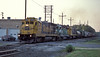 At the end of the day ATSF 6365 leads BN2929 and LRCX9523 through Olathe on 19 July 1998