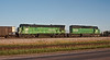 Burlington Northern SD40-2 8033 and C30-7 5583 are at the yard in Alliance, Nebraska on 12 July 1998