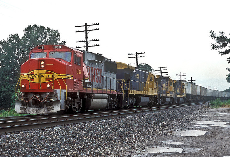 Santa Fe GP60M 108, LCRX SF30C 9518 and Santa Fe B40-8 7424 and 7431 pass Camden with an eastbound pig train on 25 July 1998