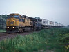 Very early in the morning of 10 July 1998 and I'm driving west along US30 out of Fremont - a constant stream of trains makes progress very slow! Near Ames in very overcast pre-dawn light Chicago North Western C44-9W 8621 and MPI leaser SD45 9018 hurry east with a long trailer train