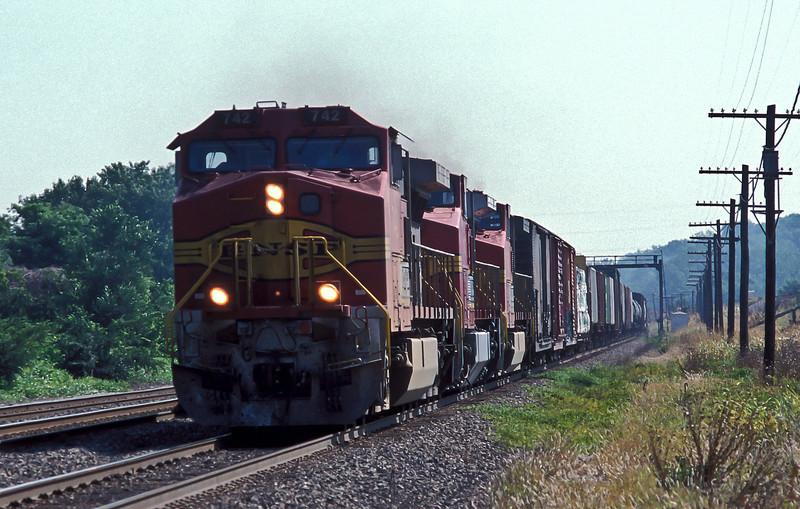 BNSF 752, 915 and 748 rush a manifest service through Holliday on 20 July 1998