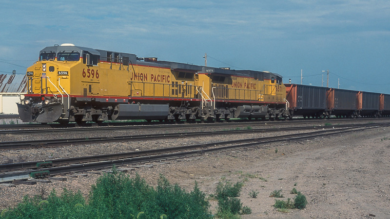 Another load of coal empties heads back to the Powder River and passes Fremont on 9 July 1998 behind UP C44-9ACW 6596 and 6571.