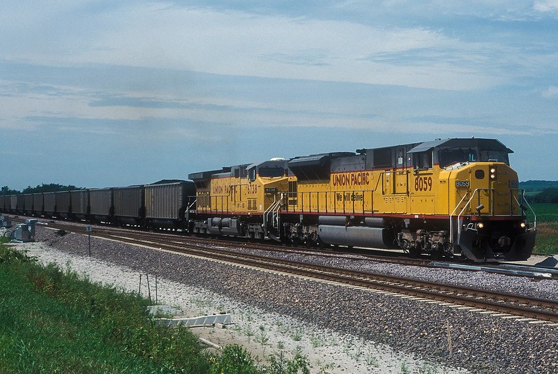 Coal is the lifeblood of the UP main line though Nebraska and Iowa - on 9 July 1998 UP SD9043MAC 8059 and C44-9ACW 6738 head west at Haley.