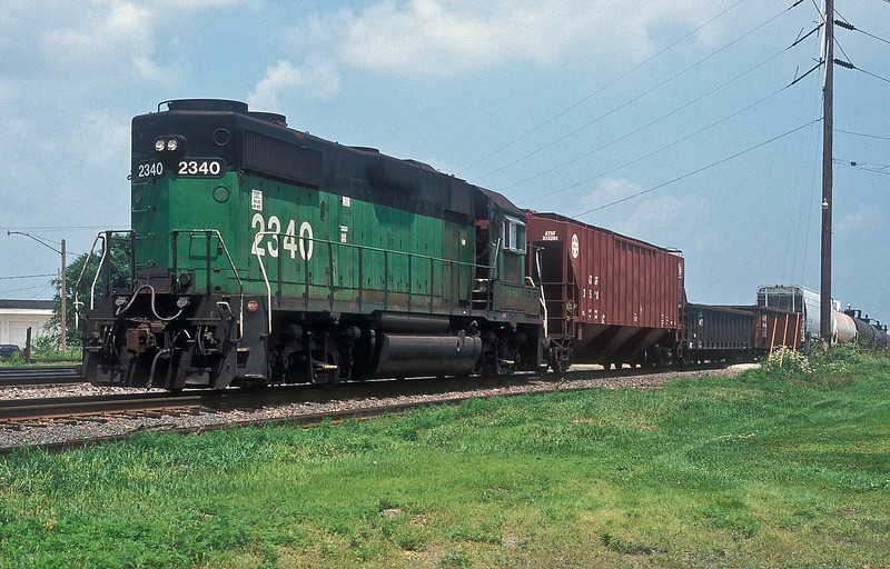 The mainline through Clinton is Union Pacific territory but Burlington Northern work in on a branchline to service the customers on a small yard system - GP38-2 2340 does the honours on 8 July 1998