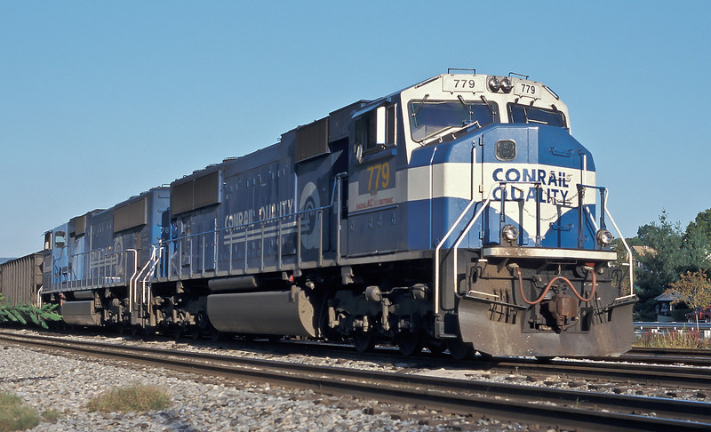 The final Conrail paint scheme for the AC locos included more white on the cabs - now wearing their CSX numbers SD70MAC 779 and 787 are at Brunswick with a coal service on 7 October 1999