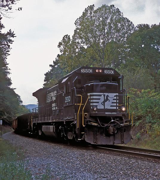 Norfolk Southern B32-8 3550 runs through the woods at Dearmond on 28 September 1999