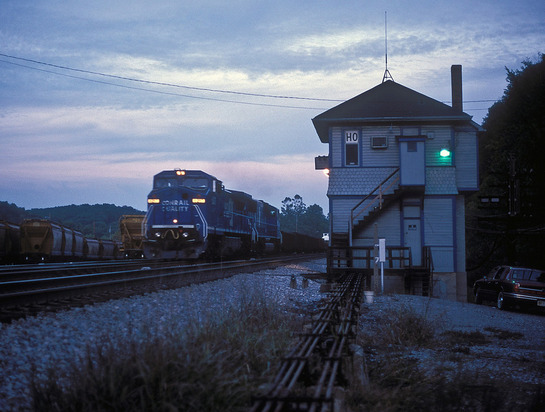 The light of the day had almost gone as Conrail C44-9W and SD60M 5522 pass the tower at Hancock on the old Baltimore and Ohio line from Washington on 5 October 1994