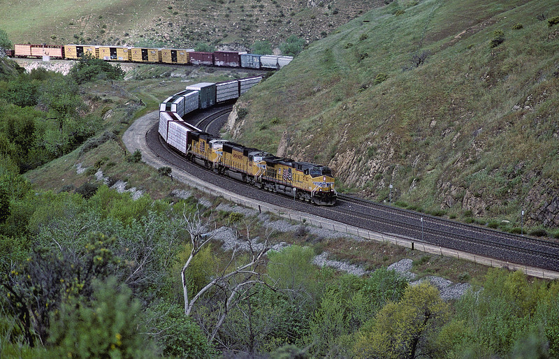 With a long train of various wagons Union Pacific AC44ACTE 5782, SD70M 4144 and 5025 approach Caliente on 20 March 2005