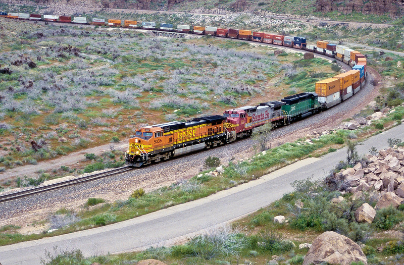 A long double stack is headed by BNSF Dash 9 5335 in Kingman Canyon on 19 March 2005