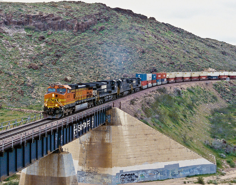 BNSF C44-9W 4075 leads three Norfolk Southern units with an eastbound stack train at Kingman Canyon on 19 March 2005