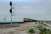 East Siberia in the early morning of 18 March 2005 and BNSF C44-9W 5271, SD40-2 6740, C44-9W 4590, Canadian National 2656 and SD40-2 6856 provide an interesting mix on a westbound manifest service