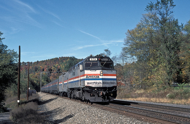 The eastbound 'Pennsylvanian' passes Petersburg with Amtrak F40PH 379 on the point on 17 October 1994