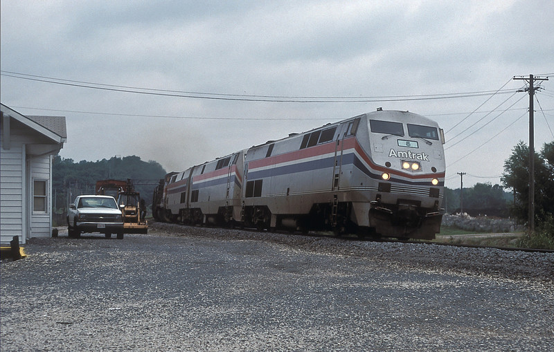 Amtrak train number 4 with loco number 5 in the lead! B42-9PH 5, 24, 42 and B32-8HDM 513 are heading toward Chicago, passing Sugar Creek on 25 July 1998