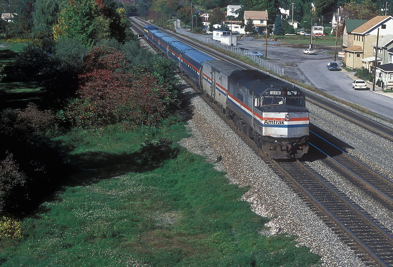 Amtrak F40PH 219 rushes through Lilly with a weatbound with 'private varnish' on the rear on 2 October 1994