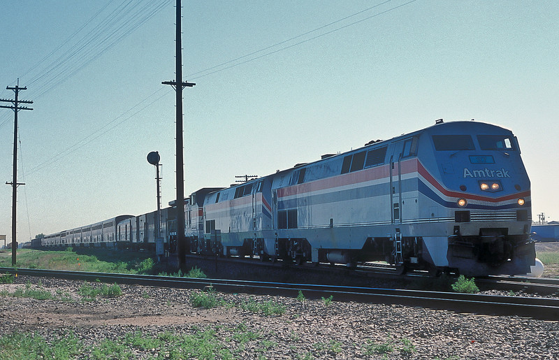 Amtrak B42-9PH 27 and 65 plus B32-8HDM 507 roll through Commerce City on their way to Denver with the 'California Zephyr' on 18 July 1998
