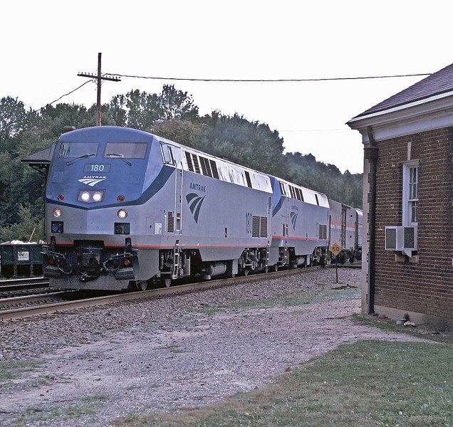Amtrak B42-9PH 180 and 126 pass the old depot building at Doswell with a northbound passenger service on 8 October 2002