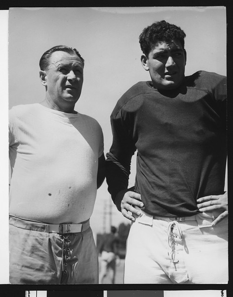 University of Southern California football coach Jeff Cravath with USC football player John Ferraro on Bovard Field, USC campus, 1946.