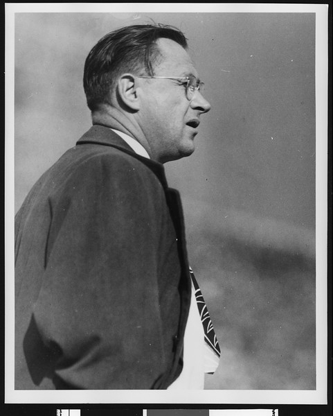 University of Southern California football coach Jeff Cravath on the sidelines at a game, location Los Angeles?, circa mid-1940s.