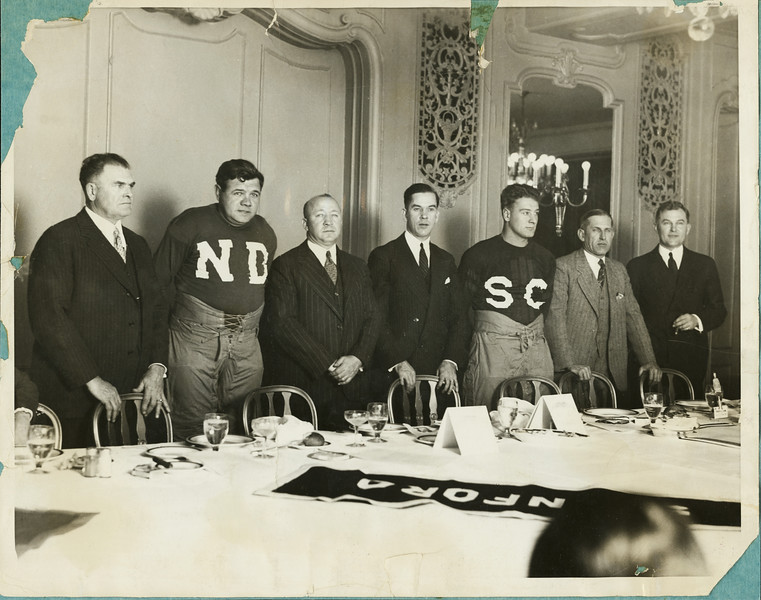 Football coaches and athletes at a dinner the night before the first University of Southern California - Notre Dame football game at Soldiers Field, Chicago, 1927