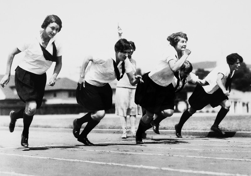 Five women runners just taking off from the starting line, Bovard Field track, USC, ca. 1920-1929