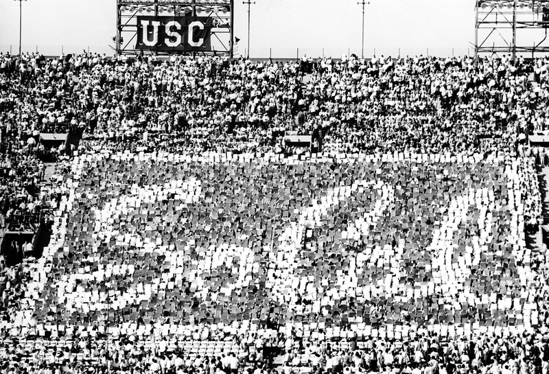 Students displaying USC's trademark, SoCal, using stunt cards during a football game, ca. 1923