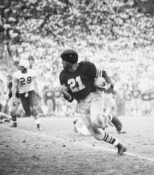 University of Southern California player Al Carmichael running with the football, 1952