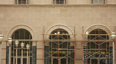 6/10/2010 - installing the stone artwork over the main entrances