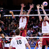 Lewis University opposite Geoff Powell (13) spikes the ball past USC middle blocker Steven Shandrick (18) during set 1 of the 2012 NCAA Men's Volleyball National Championship Semifinal game between the University of Southern California and Lewis University at the USC Galen Center in Los Angeles on May 3, 2012. The winner will advance to play UC Irvine in the championship game to be played Saturday May 5, 2012. (AP Photo/Pierson Clair)