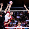 USC's Tony Ciarelli (14) spikes the ball past Lewis University's Jay Petty (19) during set 1 of the 2012 NCAA Men's Volleyball National Championship Semifinal game between the University of Southern California and Lewis University at the USC Galen Center in Los Angeles on May 3, 2012. The winner will advance to play UC Irvine in the championship game to be played Saturday May 5, 2012. (AP Photo/Pierson Clair)