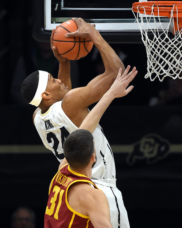 . George King, of CU, rebounds in front of Nick Rakocevic, of USC.  Cliff Grassmick / Staff Photographer/ February 21, 2018