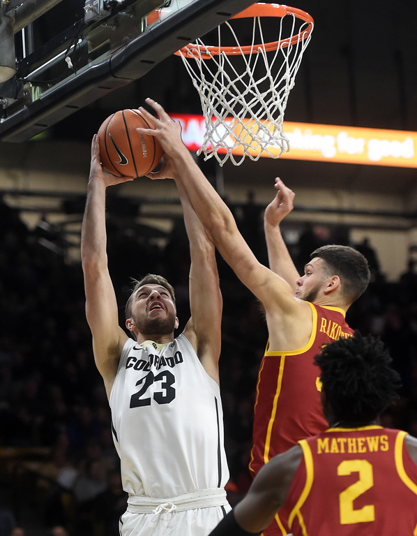 . Lucas Siewart, of CU, goes up on Nick Rakocevic, of USC.   Cliff Grassmick / Staff Photographer/ February 21, 2018