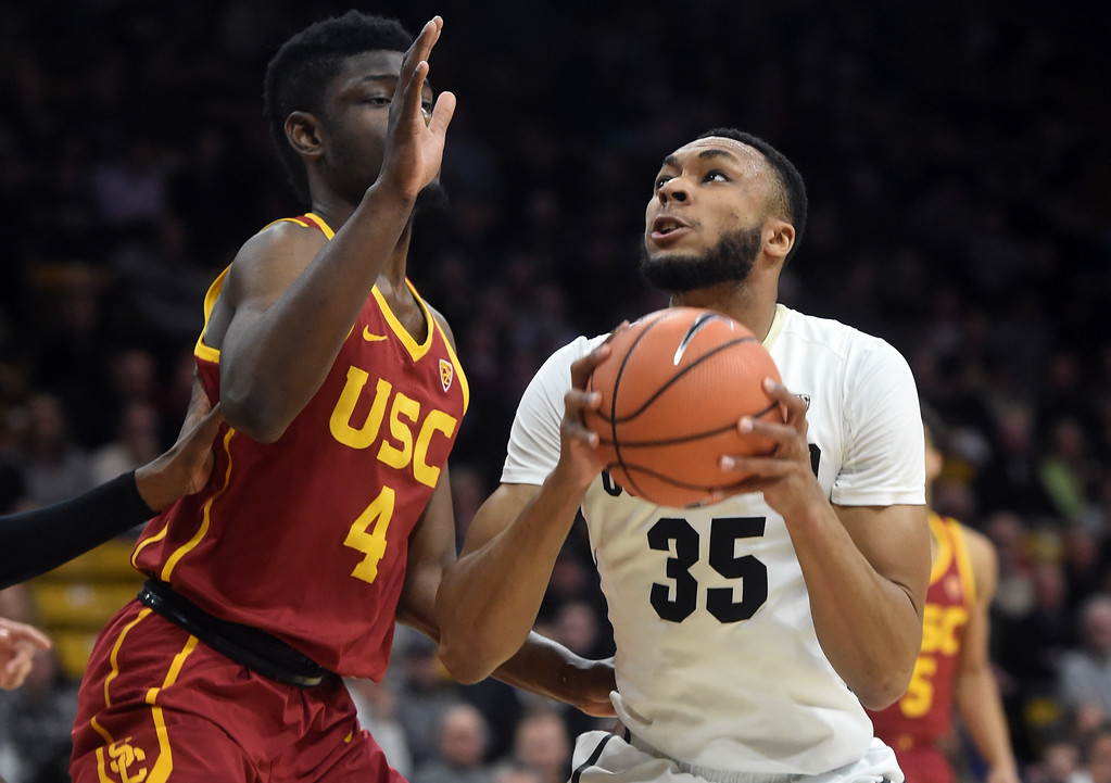. Dallas Walton, of CU, tries to score on Chimezie Metu, of USC.  Cliff Grassmick / Staff Photographer/ February 21, 2018