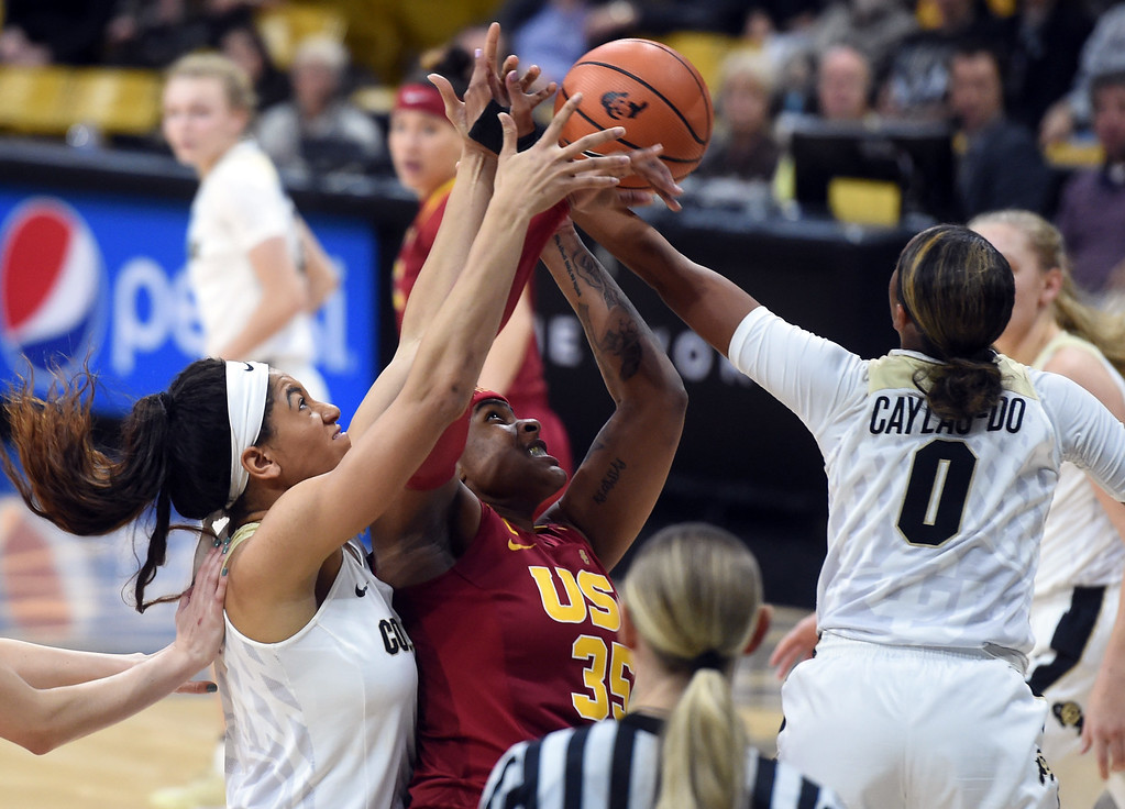 . Janea Bunn, left, of CU, and Quinessa Caylao-do, of CU, battle with Kristen Simon, of USC, during the game on January 12, 2018.  Cliff Grassmick / Staff Photographer/ January 6, 2018