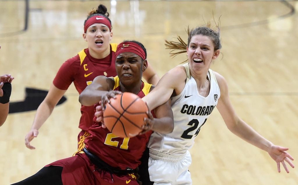 . Aubrey Knight, of CU, tries to get the ball from Aliyah Mazyck, of USC, during the game on January 12, 2018.  Cliff Grassmick / Staff Photographer/ January 6, 2018