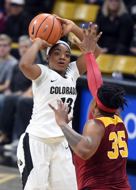 . Brecca Thomas, of CU, shoots over Kristen Simon, of USC, during the game on January 12, 2018.  Cliff Grassmick / Staff Photographer/ January 6, 2018
