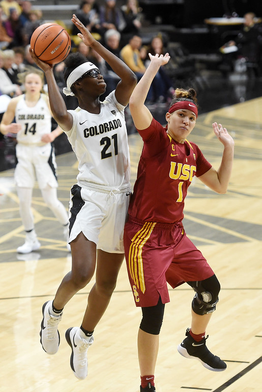 . Mya Hollingshed, of CU, shoots over Jordan Adams, of USC, during the game on January 12, 2018.  Cliff Grassmick / Staff Photographer/ January 6, 2018