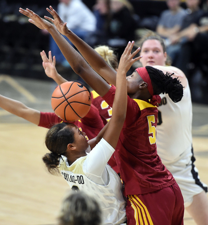 . Quinessa Caylao-do, of CU, runs into Ja\'tavia Tapley, of USC, during the game on January 12, 2018.  Cliff Grassmick / Staff Photographer/ January 6, 2018