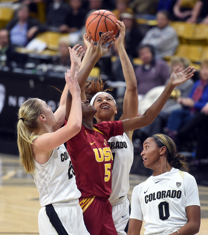 . Annika Jank, Janea Bunn, and Quinessa Caylao-do, of CU, battle with Ja\'tavia Tapley, of USC, during the game on January 12, 2018.  Cliff Grassmick / Staff Photographer/ January 6, 2018