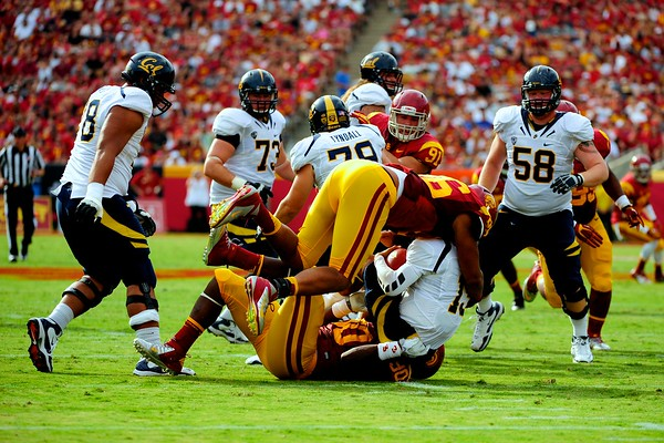 No. 96, Wes Horton with the tackle during the game between the USC Trojans and the Cal Golden Bears at the Coliseum in Los Angeles, CA on September 22, 2012.