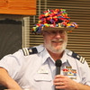 "John Milczewski models ""balloon hat"" made by Julie Neil for the raffle"