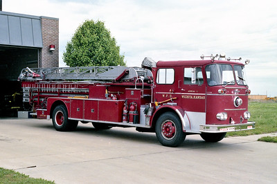 WICHITA FD  AERIAL 13  1963 SEAGRAVE   65'   OFFICERS SIDE  CLOUDY