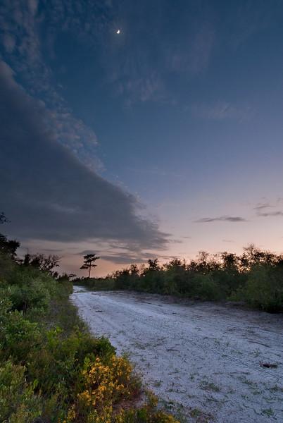 Evening falls as the moon sets over Flamingo Villas