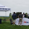 NYSGA Committee member going over player information at starting tee