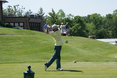 Chris Walsh, professional from Charlotte, NC, tees off on the par 4 10th at Springfield CC.
