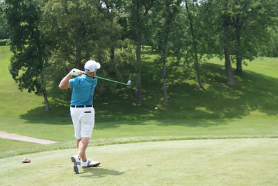 Rob Ronk, professional from Canada, hits his tee shot off of the par 4 1st at Springfield CC.