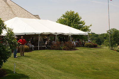 The gallery on the patio at Springfield Country Club watches action on the par 4 18th.