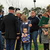 The family of CPL Luxmore, killed in Afghanistan in June 2012, grieve as medals awarded to CPL Luxmore posthumously for his service are cited at the sight of the memorial tree planted in his honor on Ft. Stewart's Warrior's Walk.