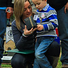 The widow of CPL Luxmore, killed in Afghanistan in June 2012, shows their son medals just awarded to CPL Luxmore posthumously for his service at the sight of the memorial tree planted in his honor on Ft. Stewart's Warrior's Walk. 15 DEC 2012 marked the 6th annual Wreaths for Warriors Walk ceremony commemorating the fallen from 3rd INF DIV during the Christmas holiday season.