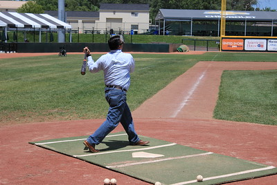 Don Wyatt, Vice President of News for Digital First Media's Michigan group, watches the flight of his hit during batting practice.